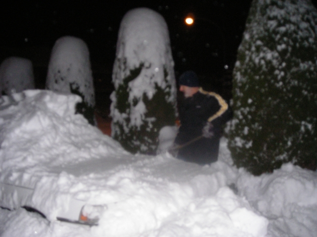 Bill trying to dig car out of the snow