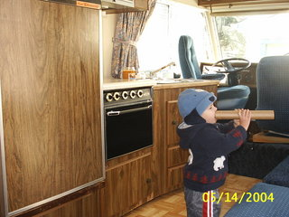 This is the kitchen part. The little boy is one of the boys already in the community. It was there trailer before the new owner got it now its ours